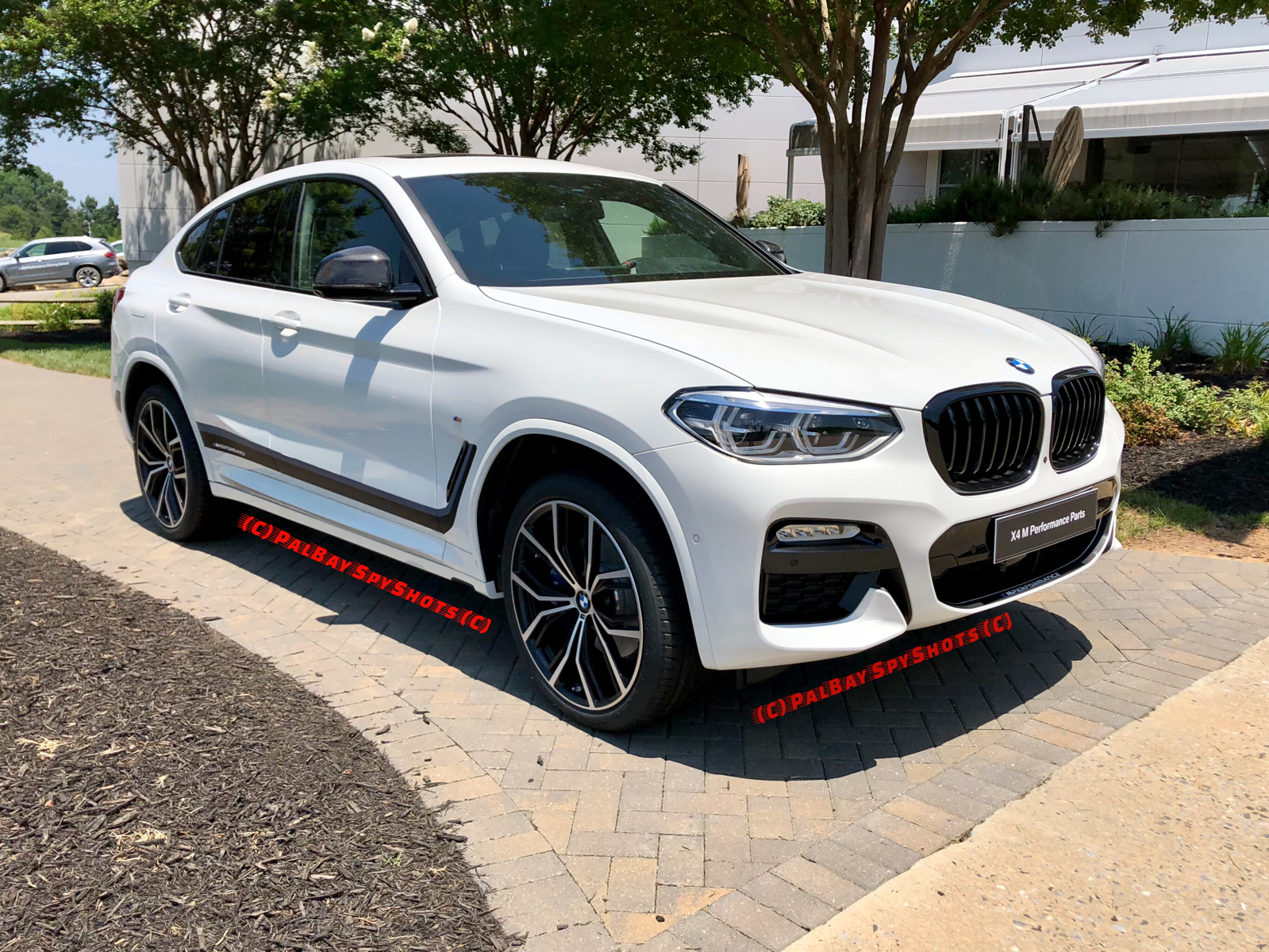 new pictures of the 2019 x4 m40i and m performance parts. Black Bedroom Furniture Sets. Home Design Ideas